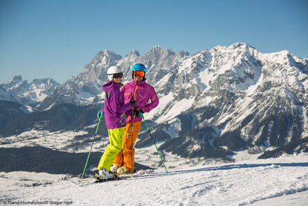 Skiing with a view of the Dachstein massif